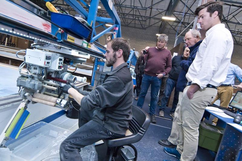 Shane Elliott, designer for TP52 Phoenix 2 and Grant Spanhake, watch as 3Di tapes are loaded into a tape head - photo © North Sails