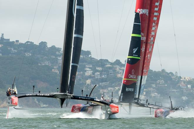 Oracle Team USA and Emirates Team New Zealand cross the start of race five on day three of the America's Cup 34.  San Francisco. 10/9/2013 © Chris Cameron/ETNZ http://www.chriscameron.co.nz