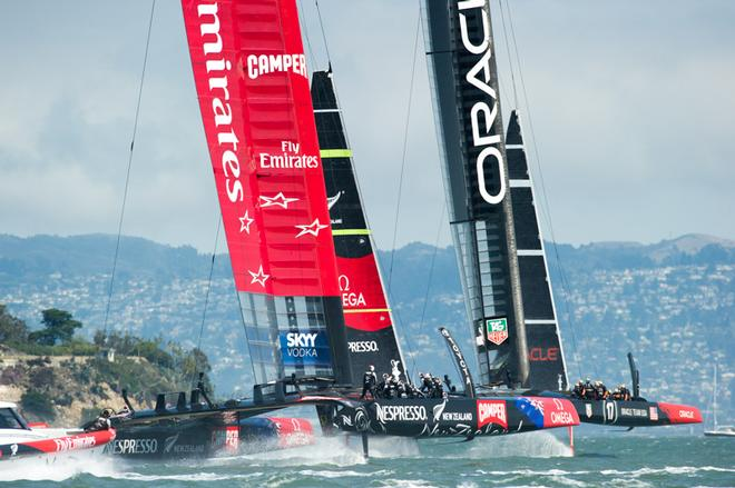 Emirates Team New Zealand follows Oracle Team USA around the first mark in race five on day three of the America's Cup 34.  San Francisco. 10/9/2013 © Chris Cameron/ETNZ http://www.chriscameron.co.nz