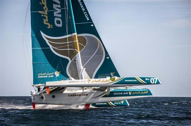 OMAN AIR MUSADAM flies two hulls on approach to the Fastnet Rock ©  Rolex/Daniel Forster http://www.regattanews.com