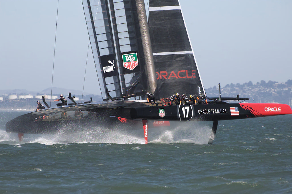 Oracle crew continue to move to the new side during the gybe.  - America's Cup © Chuck Lantz http://www.ChuckLantz.com
