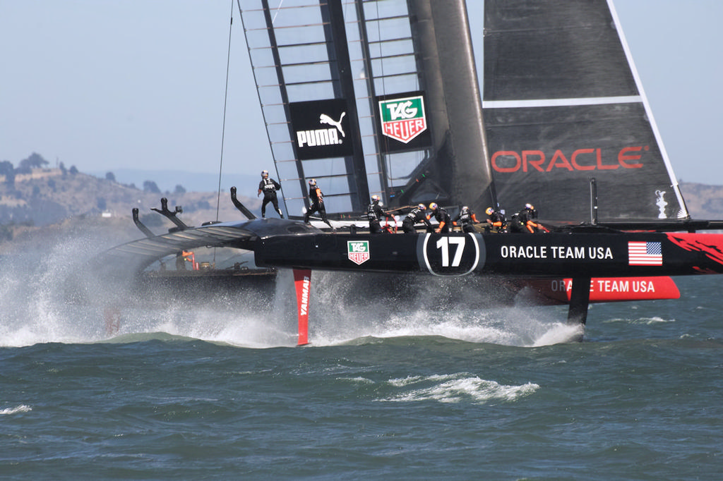 Other crew begin running across the trampoline - America's Cup © Chuck Lantz http://www.ChuckLantz.com