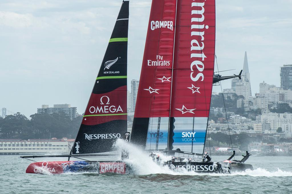 Emirates Team New Zealand bury the bows in the bear away at the top mark in their first race of the Louis Vuitton finals against Luna Rossa Challenge. Rob Waddell and Chris Ward were lost over board.17/8/2013 © Chris Cameron/ETNZ http://www.chriscameron.co.nz