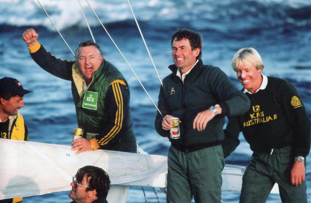 Alan Bond punches the air after Australia II wins.From left to right, John Bertrand, Alan Bond, Ben Lexcen (bottom), Hugh Treharne and Damien Frewster © Maritime Productions LLC http://www.maritimeproductions.tv/