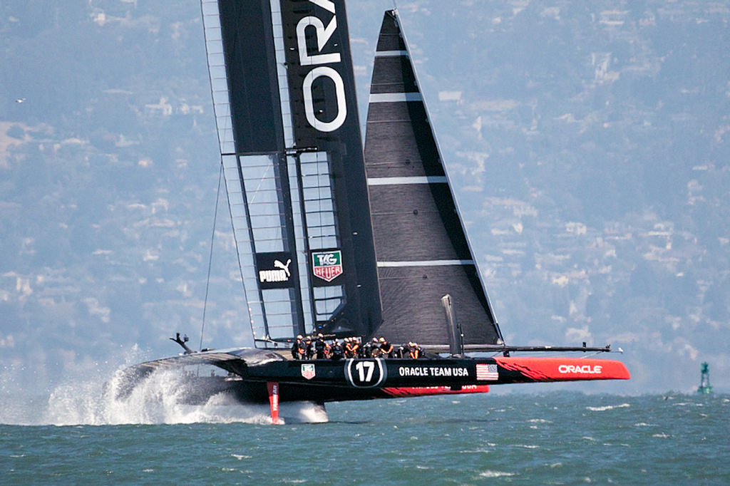 Oracle flies on her foils, showing their shorter headsail.  - America's Cup © Chuck Lantz http://www.ChuckLantz.com