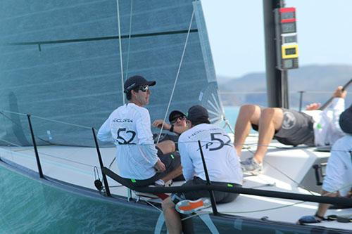 Double Olympic Gold Medallist Malcolm Page in sunglasses calling the shots aboard Hooligan © Sail-World.com http://www.sail-world.com
