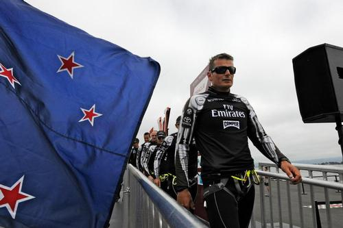 Dean Barker, skipper of Emirates Team New Zealand and his mates, walk off the stage at the Dock Out show and on to winning the 6th Match Race of the Louis Vuitton Cup Finale on August 23, 2013 in San Francisco California. ©  SW