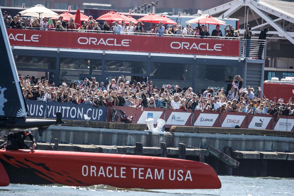 Oracle Team USA passes their fans Race Day 9  © ACEA / Photo Abner Kingman http://photo.americascup.com