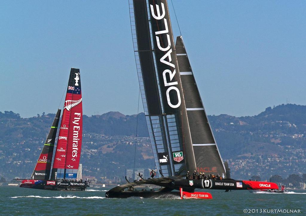 Oracle Team USA and Emirates Team NZ on Day 13, America's Cup 2013 © Kurt Molnar