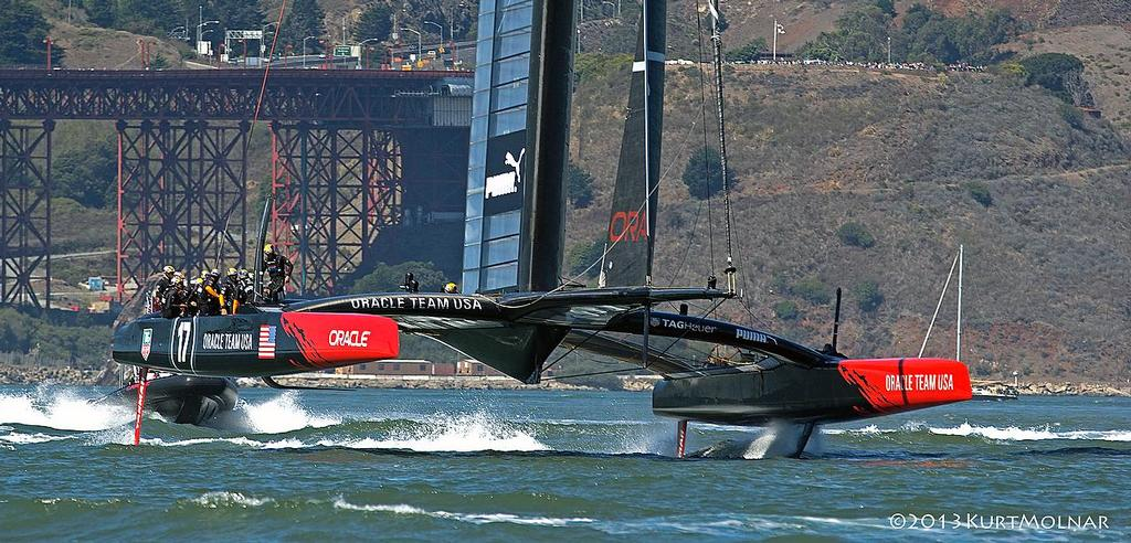 Oracle Team USA foiling on Day 13, America's Cup 2013 © Kurt Molnar