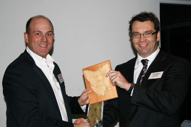 Robert Case receives his 25 Hobarts plaque from Matt Allen at the CYCA - Rolex Sydney to Hobart  © CYCA Staff .