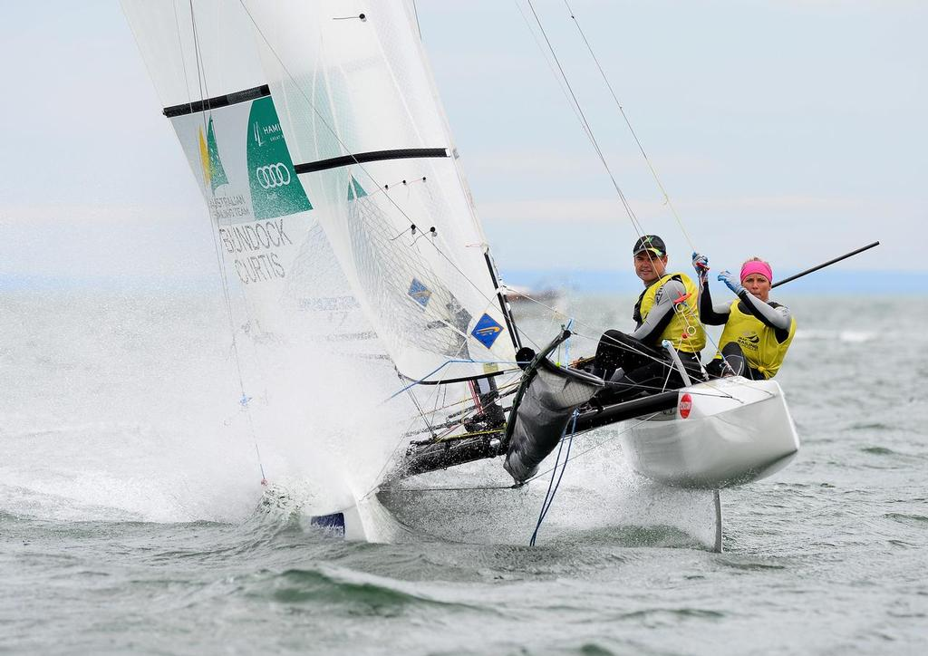 Darren Bundock and Nina Curtis (AUS) win the Nacra17 at the ISAF Sailing World Cup Melbourne © Jeff Crow/Sail Melbourne http://www.sportlibrary.com.au