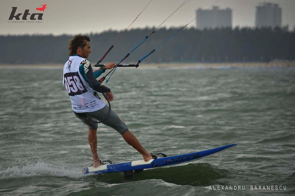 Florian Gruber from Germany in action during day two of the IKA Kiteboard Race World Championship 2013 on November 21, 2013 at King Bay Qionghai, China. © Alexandru Baranescu