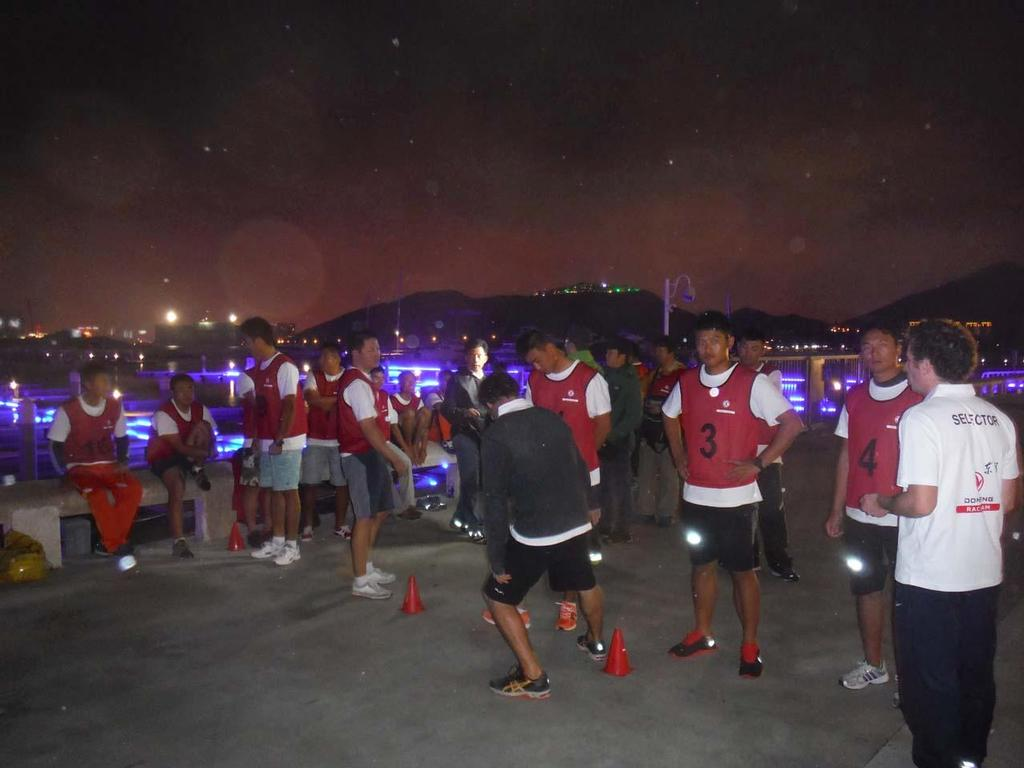 Candidates take part in physical training activities outside Serenity Marina in Sanya ©  OC Sport http://www.ocsport.com/