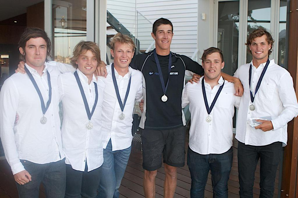 Sam Gilmour and his team accept their medallions. © Bernie Kaaks