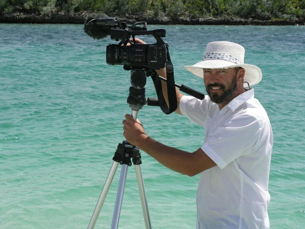 Paul Shard with camera (portrait) in the Bahamas filming for the Distant Shores sailing TV series © Sheryl Shard