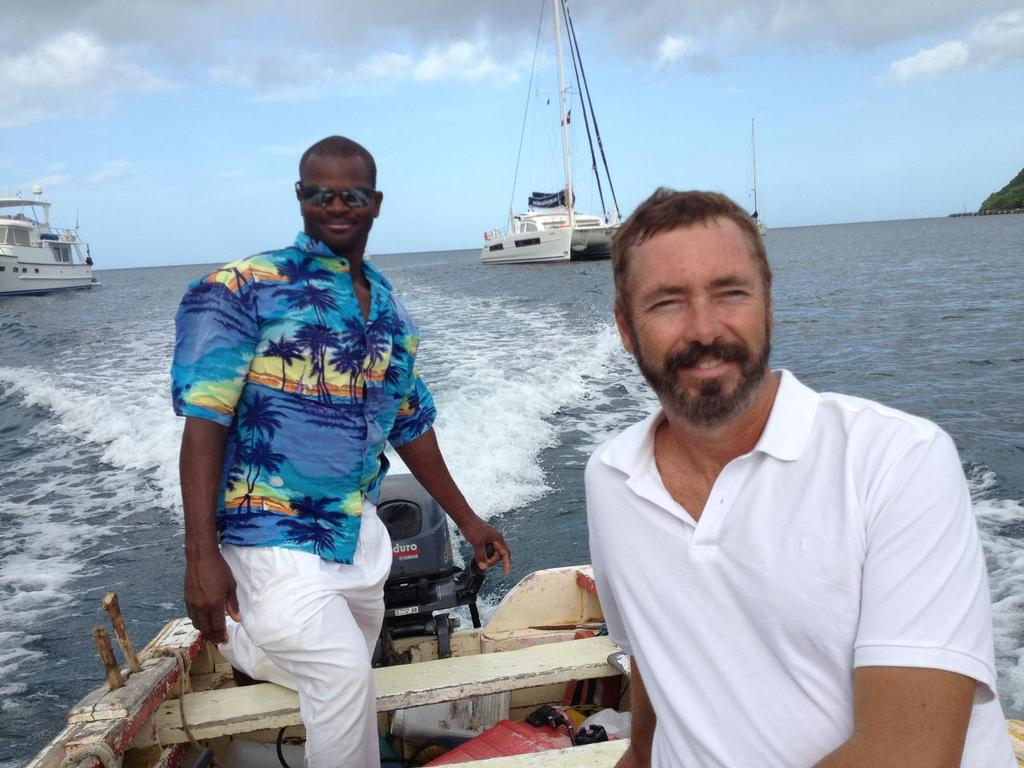 Paul with guide, Martin Carrierre, on a shoot in Dominica. Finding work you can do while cruising is the best of both worlds. © Sheryl Shard