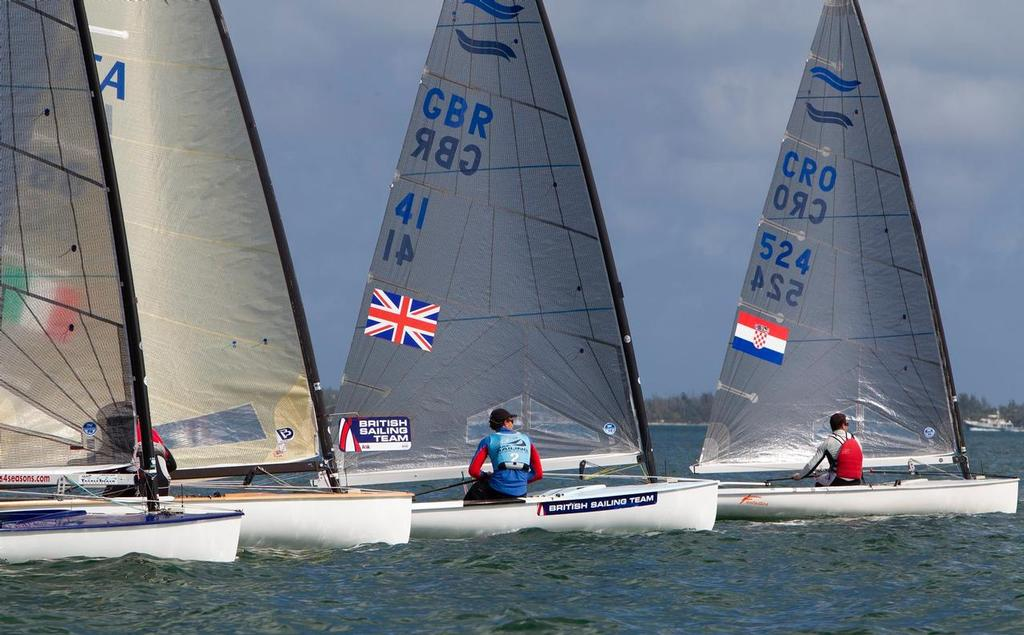 Giles Scott counts the boats between him and AUS Tweddell - ISAF Sailing World Cup Miami 2014 © Richard Langdon/British Sailing Team