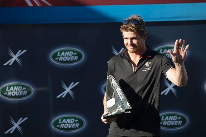 Olympic Gold Medallist Tom Slingsby with his Land Rover Above and Beyond Award presented in recognition of the greatest tactical performance and improvement seen this year on a debut appearance at the Extreme Sailing Series™. © Lloyd Images