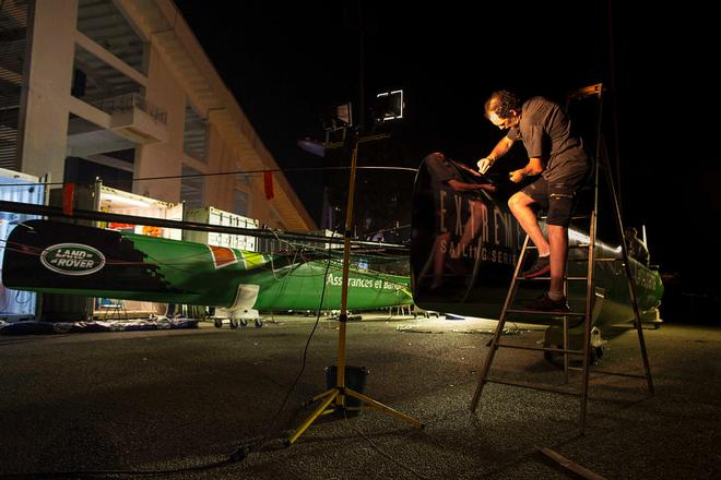 The Extreme Sailing Series 2014. Act 1. Singapore. Day 3.  Groupama Team France skippered by Franck Cammas (FRA) make repairs and re-rig their yacht overnight <br />  &copy; Lloyd Images