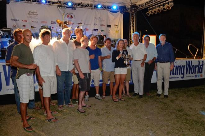 Mike Slade and crew of ICAP Leopard collect the Line Honours Trophy for the Yachting World Round Antigua Race © Ted Martin