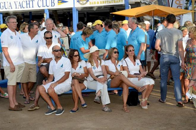 Crews wait for the daily prizes to be presented. Today's prize giving was sponsored by Colombian Emeralds © Ted Martin