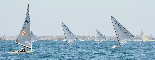 Greg Douglas (l.) tracks Caleb Paine (r.) downwind in last race of Finn North Americans at ABYC © Rich Roberts