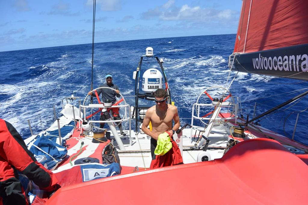 French Sailors Eric Peron and Thomas Rouxell enjoy a rare moment of calm and sunshine on deck © Dongfeng Race Team