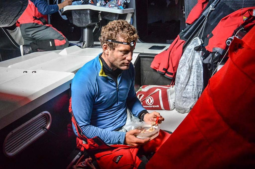Skipper Charles Caudrelier appreciates the freeze dried food onboard as Dongfeng cross the Atlantic © Dongfeng Race Team