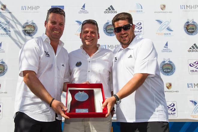 2014 Match Race Germany - James Pleasance (centre) presenting commemorative Garrard plaque to the organisers, Eberhard Magg and Harald Thierer. ©  Ian Roman / WMRT