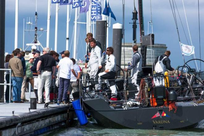 The yacht's designer, Jason Ker, spectators and the RORC Race team on the dock to greet the crew of Varuna at Trinity Landing, Cowes after the finish. © Hamo Thornycroft http://www.yacht-photos.co.uk