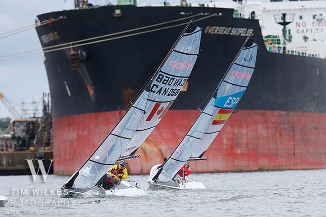 Canada and Spain SKUD teams with a container ship in the background - 2014 IFDS World Championship © Tim Wilkes