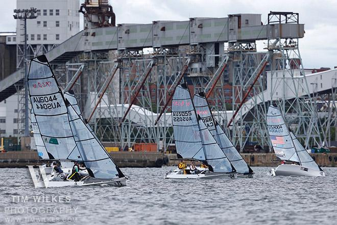 SKUDs with the Halifax grain terminal/waterfront behind them - 2014 IFDS World Championship © Tim Wilkes