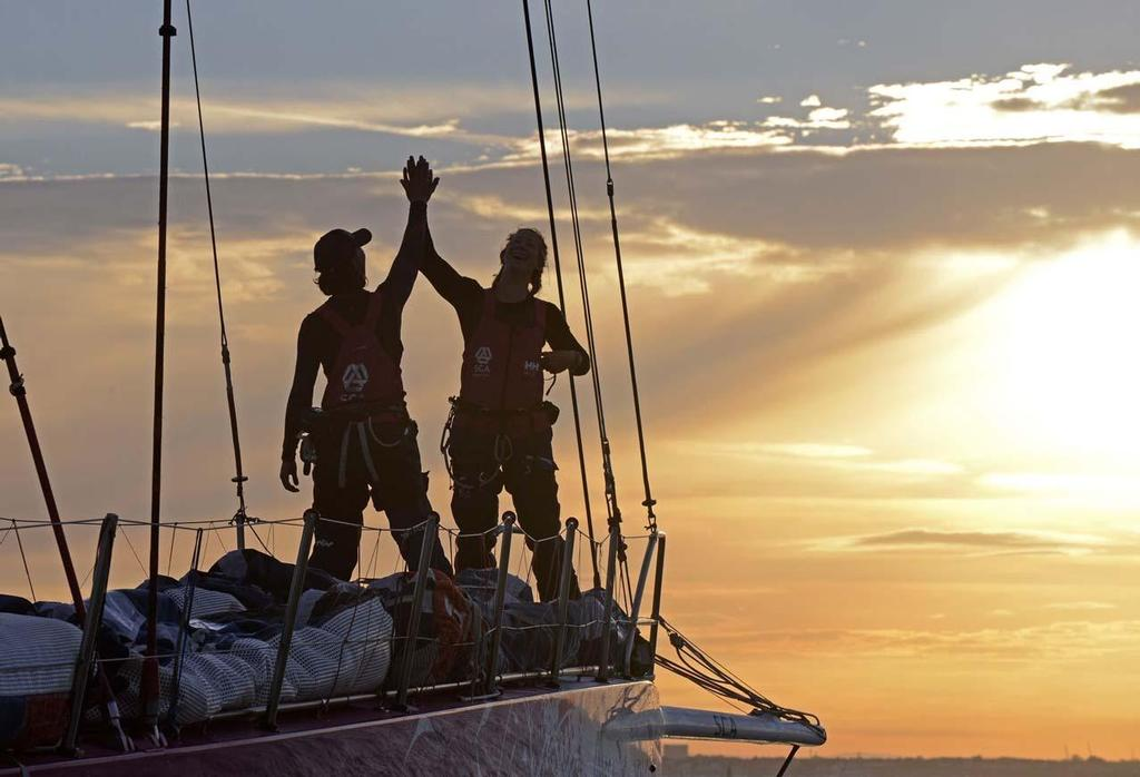 Team SCA finishes at dawn off Cowes to beat the all female round Britain record. SCA skippered by Sam Davies, crossed the finish line of the 2014 Sevenstar Round Britain and Ireland Race off the Royal Yacht Squadron, Cowes at 06.10.39 BST on Satuday 16th August 2014 with an elapsed time of 4 days, 21 hours, 00 minutes and 39 seconds. © Rick Tomlinson / Team SCA