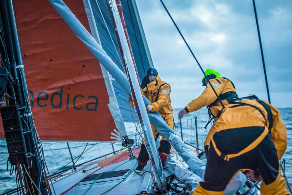 August 14, 2014. Round Britain Island Race Day 4 - OBR content Team Alvimedica: Nick Dana and Dave Swete run the bow during a frigid North Sea sail change during the RORC's Round Britain and Ireland Race. ©  Amory Ross / Team Alvimedica