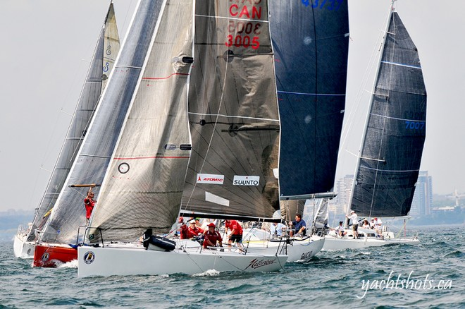 Competitors pass the commitee boat at the start of the Lake Ontario 300  © Jeff Chalmers