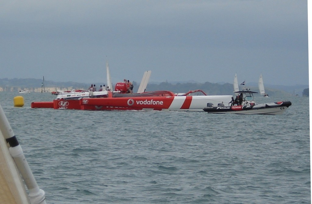 Dismasted Team Vodafone Sailing with ETNZ tenders assisting - Team Vodafone Sailing © Colin Preston