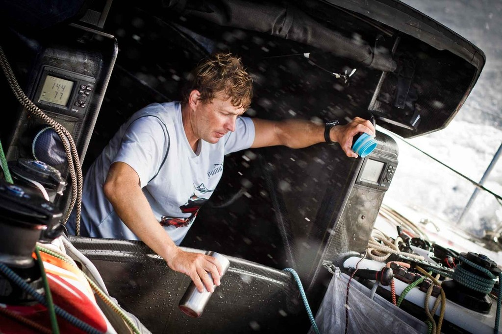 Coffee fiend Kelvin Harrap rinsing what's left in his mug before a likely mid-watch refill. PUMA Ocean Racing powered by BERG during leg 4 of the Volvo Ocean Race 2011-12 © Amory Ross/Puma Ocean Racing/Volvo Ocean Race http://www.puma.com/sailing