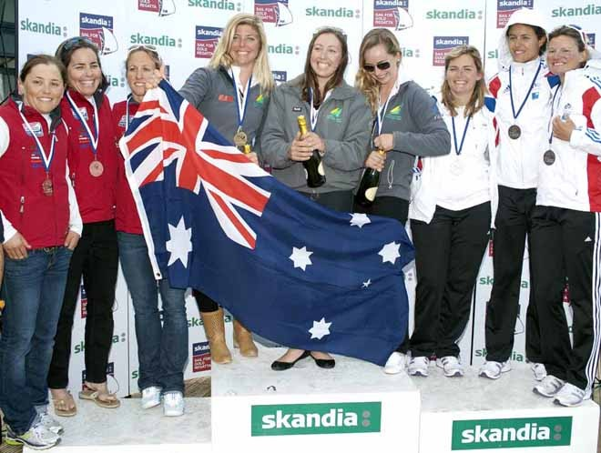 Olivia Price (AUS), Claire Leroy (FRE), Anna Tunnicliffe (USA) and teams receive awards on Day 6 of the Skandia Sail for Gold Regatta, in Weymouth and Portland, the 2012 Olympic venue. © onEdition http://www.onEdition.com