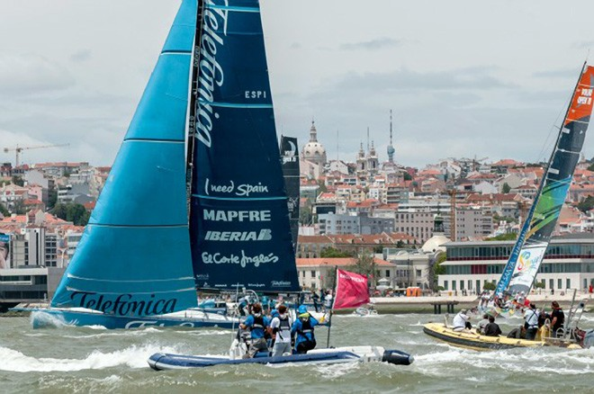 Team Telefonica, skippered by Iker Martinez from Spain is surrounded by support and spectator boats, in the Oeiras In-Port Race in Lisbon, during the Volvo Ocean Race 2011-12 © Paul Todd/Volvo Ocean Race http://www.volvooceanrace.com