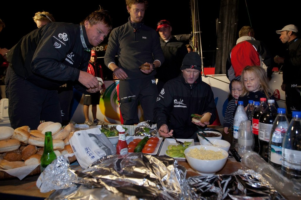 Team Sanya skippered by Mike Sanderson from New Zealand, are welcomed with burgers on the dock in Tauranga, New Zealand, after a broken rudder and hull damage forced them to sail back, during leg 5 of the Volvo Ocean Race 2011-12, from Auckland, New Zealand to Itajai, Brazil. They are now forced to retire from leg five and miss leg six of the race and ship their race boat and equipment to Miami. (Credit: Gareth Cooke/Volvo Ocean Race) © Gareth Cooke/Volvo Ocean Race http://www.volvooceanrace.com