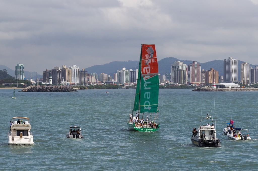 A spectator fleet follows Groupama Sailing Team, skippered by Franck Cammas from France, sailing under jury rig, as they approach the finish line in Itajai, during leg 5 of the Volvo Ocean Race 2011-12, from Auckland, New Zealand to Itajai, Brazil.  © Ian Roman/Volvo Ocean Race http://www.volvooceanrace.com