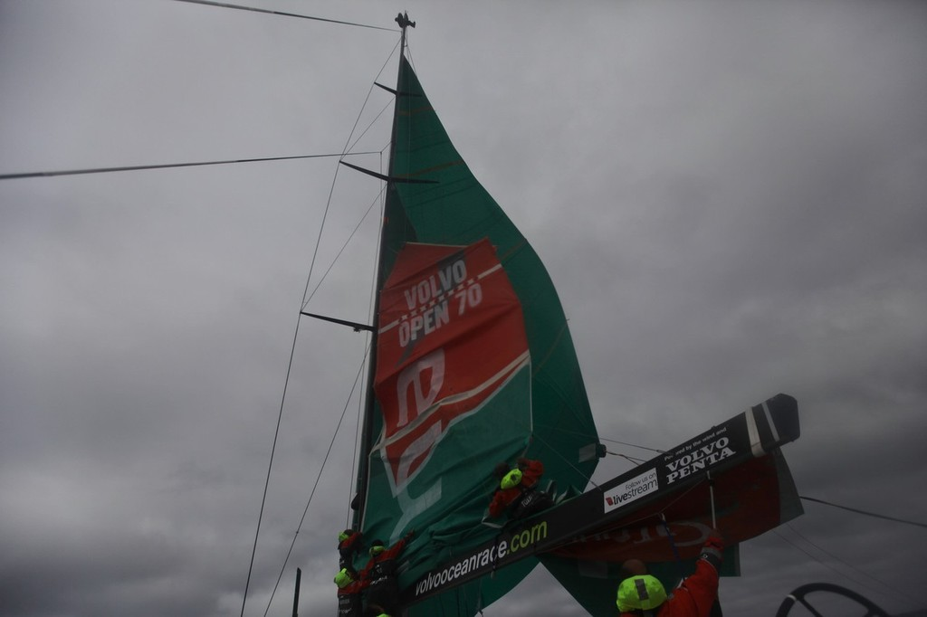 Brad Marsh is sent up the mast to try and free a stuck mainsail, onboard Groupama Sailing Team during leg 8 of the Volvo Ocean Race 2011-12, from Lisbon, Portugal to Lorient, France.  © Yann Riou/Groupama Sailing Team /Volvo Ocean Race http://www.cammas-groupama.com/