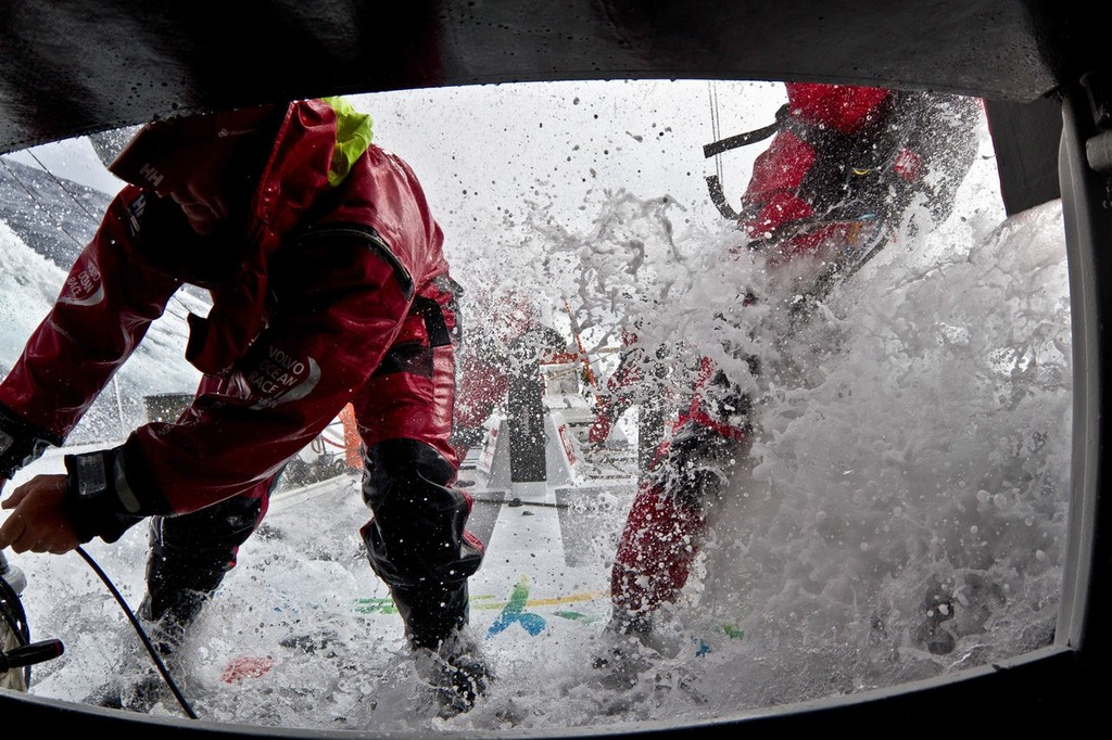 Dave Swete and Bert Schandevyl working the pit, onboard Team Sanya during leg 8 of the Volvo Ocean Race 2011-12, from Lisbon, Portugal to Lorient, France.  © Andrés Soriano/Team Sanya/Volvo