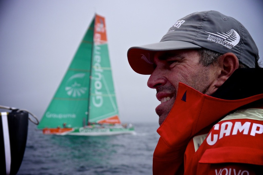 Camper's Stu Bannatyne on the helm as they pass 2011-12 overall Volvo Ocean race winner, Groupama, on the way to win Leg 9 of the Volvo Ocean Race 2011-12 © Hamish Hooper/Camper ETNZ/Volvo Ocean Race