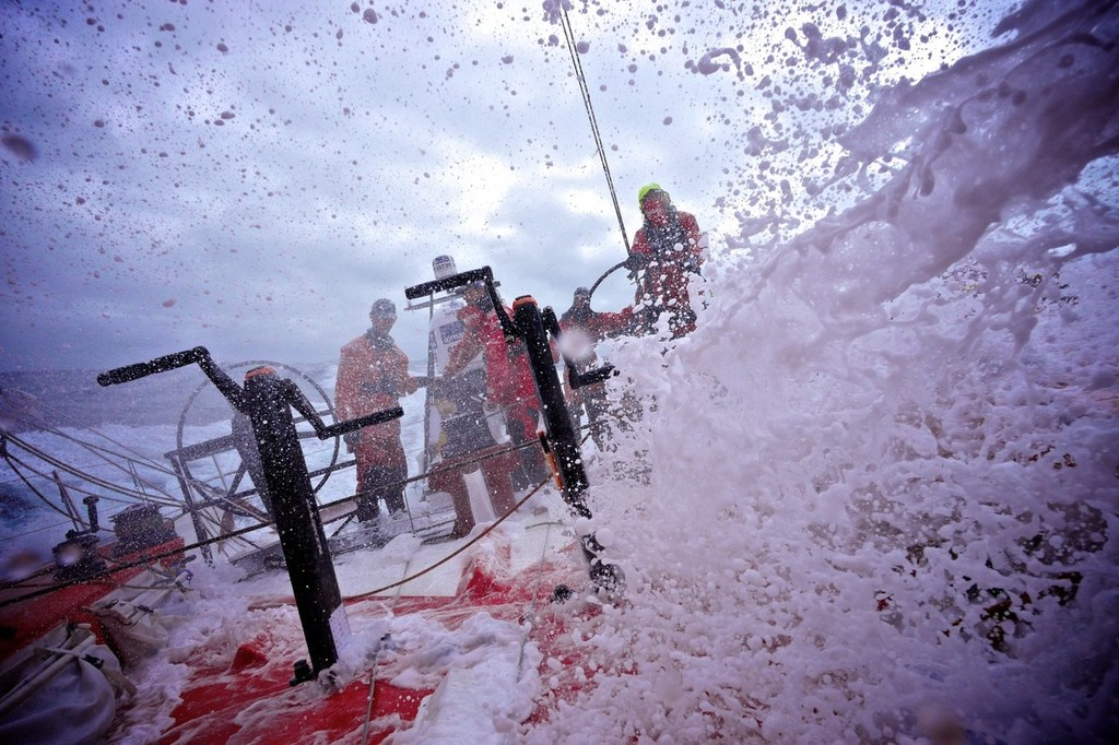 huge walls of white water crash over the deck onboard CAMPER with Emirates Team New Zealand during leg 8 of the Volvo Ocean Race 2011-12, from Lisbon, Portugal to Lorient, France. (Credit: Hamish Hooper/CAMPER ETNZ/Volvo Ocean Race) © Hamish Hooper/Camper ETNZ/Volvo Ocean Race