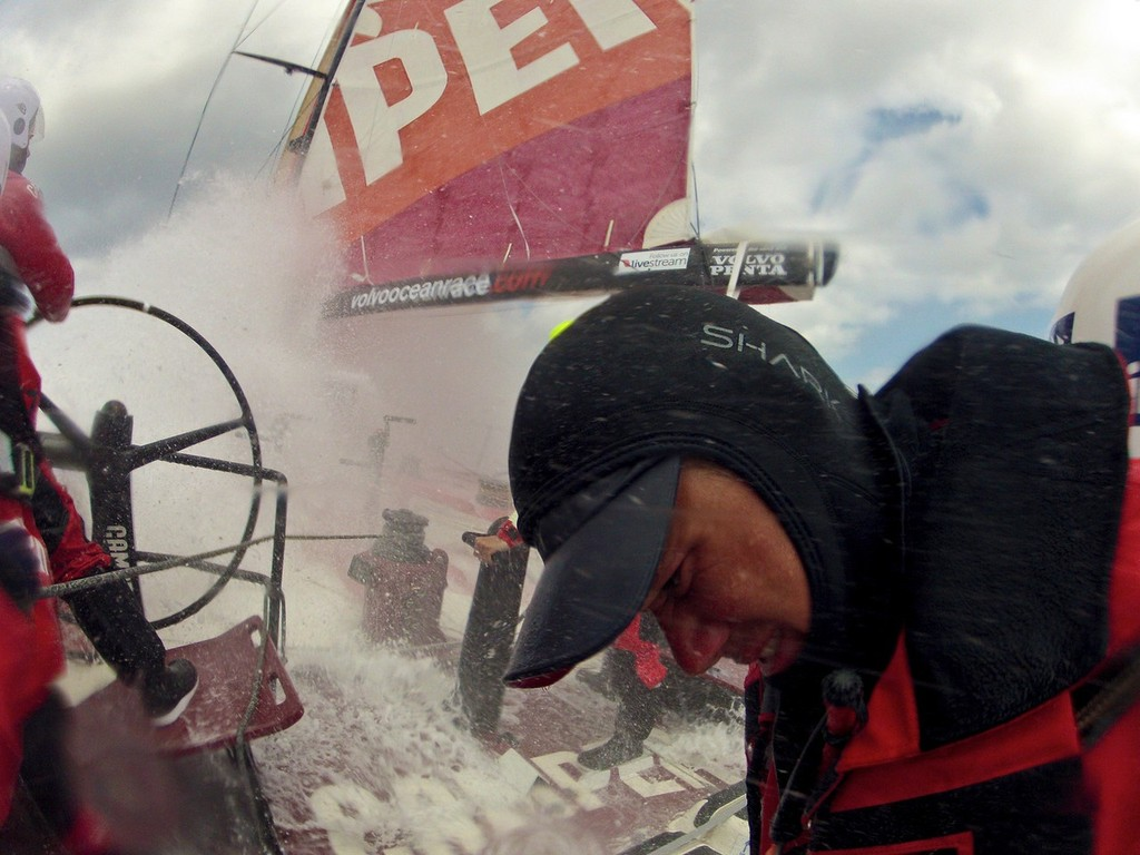 Nick Burridge squints away from the wall of white water onboard Camper with Emirates Team New Zealand during leg 8 of the Volvo Ocean Race 2011-12, from Lisbon, Portugal to Lorient, France.  © Hamish Hooper/Camper ETNZ/Volvo Ocean Race