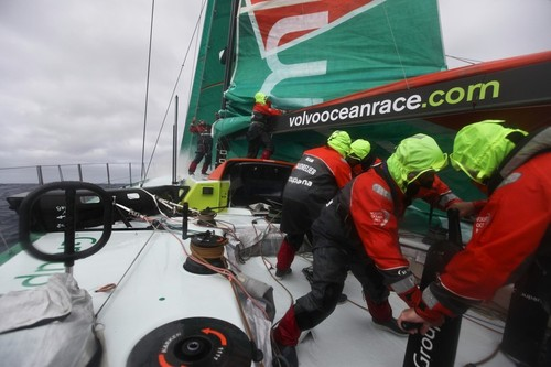The Groupama Sailing Team crew try to put the mainsail back up after it got stuck while they were putting in a reef, during leg 8 of the Volvo Ocean Race 2011-12, from Lisbon, Portugal to Lorient, France.  © Yann Riou/Groupama Sailing Team /Volvo Ocean Race http://www.cammas-groupama.com/