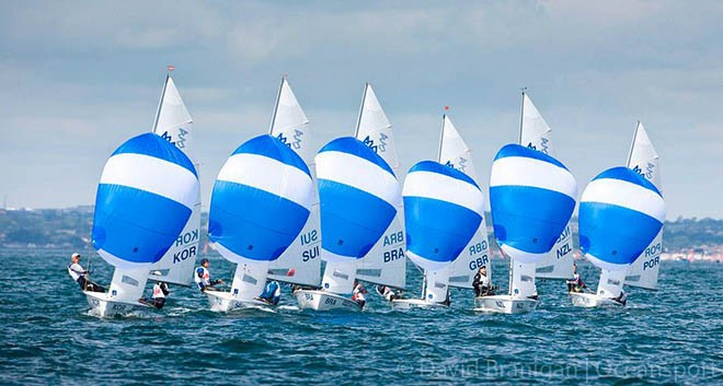 Part of the Boys 420 fleet at the ISAF Youth World Sailing Championships sponsored by Four Star Pizza on Dublin Bay, Ireland © David Branigan - Oceansport.ie