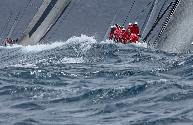 Wild Oats XI leads Ragamuffin Loyal out of the harbour - Rolex Sydney Hobart Race 2012 © Crosbie Lorimer http://www.crosbielorimer.com